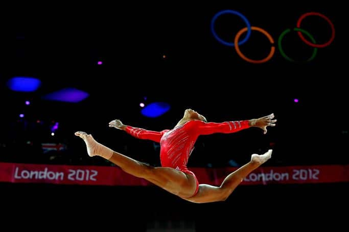 LONDON, ENGLAND - JULY 31:  Gabrielle Douglas of the United States of America competes on the balance beam in the Artistic Gymnastics Women's Team final on Day 4 of the London 2012 Olympic Games at North Greenwich Arena on July 31, 2012 in London, England.  (Photo by Ronald Martinez/Getty Images)